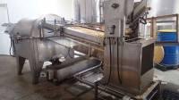 La centrifugeuse pour extraire le miel.